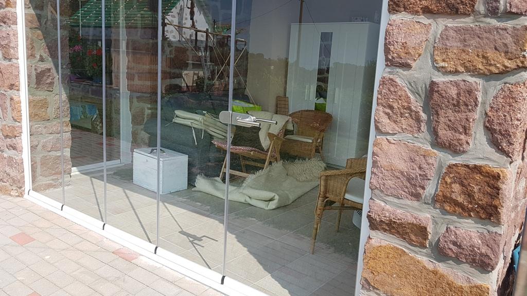 olcsó Lapozható üvegfal teraszra